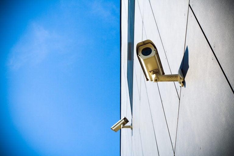 Security camera over blue sky
